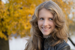 Beautiful young smiling girl outdoors Royalty Free Stock Photos