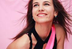 Beautiful young smiling girl on a pink background Stock Image