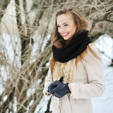 Beautiful young smiling girl in winter Royalty Free Stock Photos