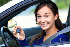 Beautiful young smiling happy girl in a car Stock Photo