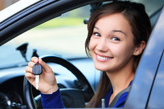 Beautiful young smiling happy girl in a car Royalty Free Stock Images