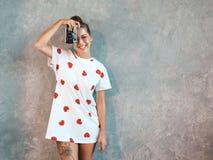 Beautiful trendy girl posing in studio stock images