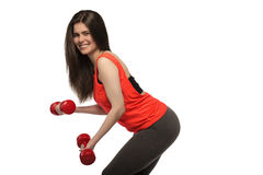 Beautiful young smiling sporty fitness woman with dumbbells Royalty Free Stock Photos