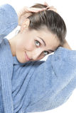 Beautiful young smiling woman in bathrobe Royalty Free Stock Photo