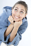 Beautiful young smiling woman in bathrobe Stock Images