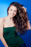 Beautiful Young Smiling Woman on Blue Stock Photos