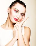Beautiful young smiling woman with bright make up Stock Photos