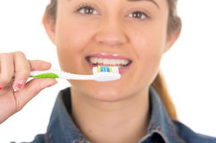 Beautiful young smiling woman brushing teeth Stock Photos