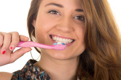 Beautiful young smiling woman brushing teeth Stock Photos