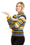 Beautiful young smiling woman in colored striped sweater Royalty Free Stock Photo