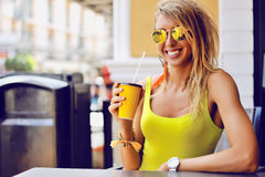 Beautiful young smiling woman with cup of drink outdoor Royalty Free Stock Photo