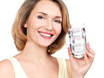 Beautiful young smiling woman with a glass of water Stock Photography