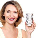 Beautiful young smiling woman with a glass of water Royalty Free Stock Photos