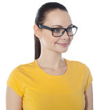Beautiful young smiling woman in glasses Stock Image