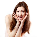 Beautiful young smiling woman happy ecstatic gesturing surprise Stock Image