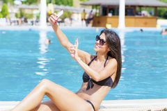 Beautiful young smiling woman having fun making selfie Royalty Free Stock Image