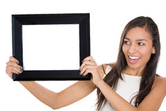Beautiful young smiling woman holding a blank picture frame Royalty Free Stock Images