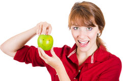 Beautiful young smiling woman holding a fun apple Stock Images