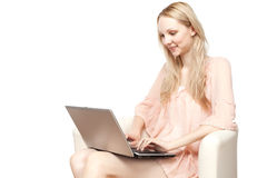 Beautiful young  smiling woman with laptop Stock Photos