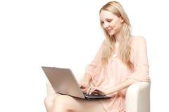Beautiful young  smiling woman with laptop Stock Photos