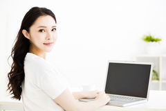 Beautiful young smiling woman  with laptop Royalty Free Stock Photos