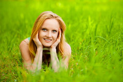 Beautiful young smiling woman lying Royalty Free Stock Image