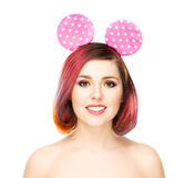 Beautiful young smiling woman in Mickey mouse ears Stock Image