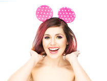 Beautiful young smiling woman in mickey mouse ears Stock Photo