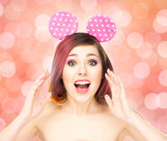 Beautiful young smiling woman in mickey mouse ears Royalty Free Stock Photo