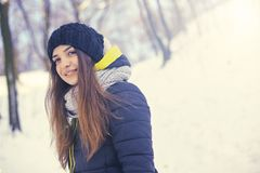 Beautiful young woman in winter. Beautiful young smiling woman outside in the winter Royalty Free Stock Photos