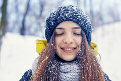 Beautiful young woman in winter. Beautiful young smiling woman outside in the winter Stock Photography