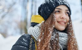 A Beautiful young woman in winter outside royalty free stock image