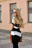 Beautiful young smiling woman posing in sunglasses Royalty Free Stock Photo