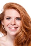 Beautiful young smiling woman with red hair and freckles isolated Stock Photo