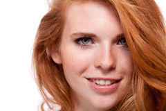 Beautiful young smiling woman with red hair and freckles isolated Stock Images