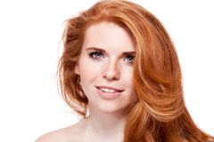 Beautiful young smiling woman with red hair and freckles isolated Royalty Free Stock Image