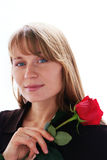 Beautiful young smiling woman with red rose.  stock image