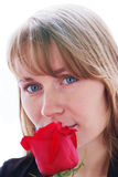 Beautiful young smiling woman with red rose Stock Photos