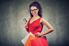Beautiful woman with shoppping bags and credit card Stock Photography