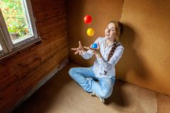 Young woman juggling Stock Images
