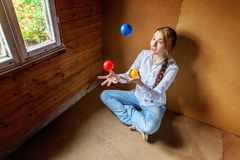 Young woman juggling Royalty Free Stock Photo