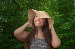 Beautiful young smiling woman in wide hat Stock Photography