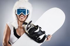Beautiful young snowboarder Stock Photos