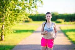Beautiful young sport girl running outdoors. Runner - woman running outdoors training for marathon run Royalty Free Stock Photos