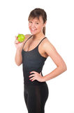 Beautiful young sport  woman with green apple, isolated on white Royalty Free Stock Image