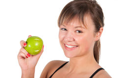 Beautiful young sport  woman with green apple, isolated on white Royalty Free Stock Photography