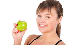 Beautiful young sport  woman with green apple, isolated on white Royalty Free Stock Photo