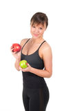 Beautiful young sport  woman with red and green apple, isolated on white Royalty Free Stock Photos