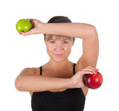 Beautiful young sport  woman with red and green apple, isolated on white Royalty Free Stock Images