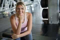 Free Beautiful Young Sport Woman Taking A Break From Exercise In Fitness Gym .girl In Sportswear Workout Rest Royalty Free Stock Image - 144751616